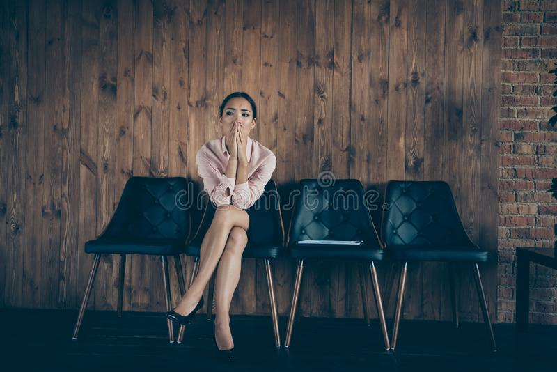 Portrait of her she nice attractive worried lady qualified specialist partner sitting on chair waiting for meeting ceo. Boss chief recruiter at modern stock photography