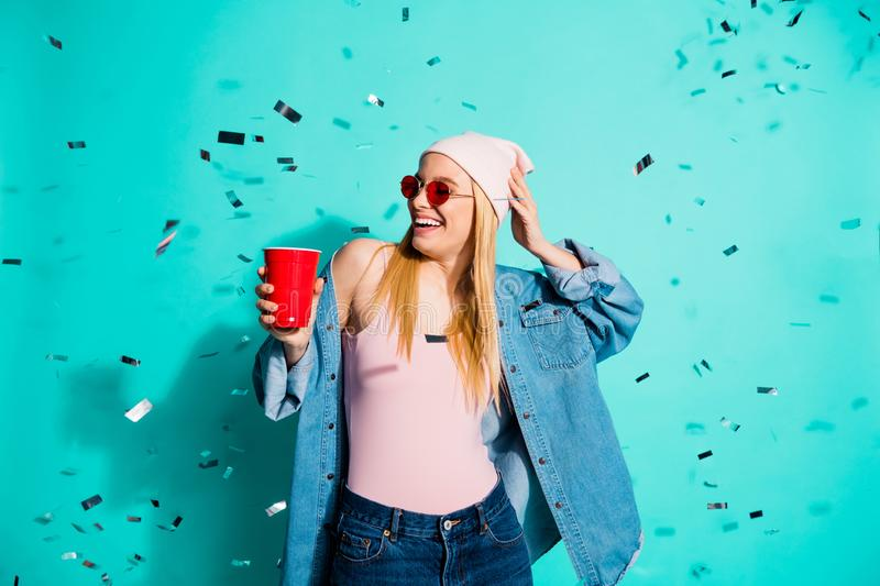 Portrait of her she nice charming cute attractive lovely cool cheerful positive girl holding in hand red cup flying. Decor rest relax isolated, over bright royalty free stock photo