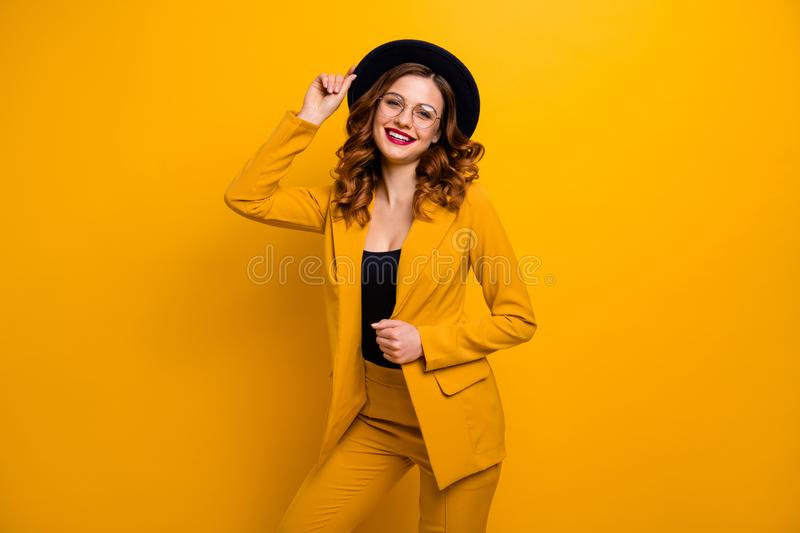 Portrait of her she nice charming cute attractive lovely fascinating gorgeous chic elegant cheerful cheery wavy-haired. Lady in yellow suit luxury isolated on stock photos