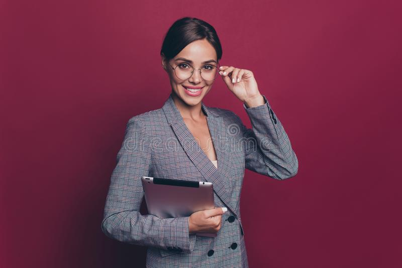 Portrait of her she nice cute attractive lovely sweet cheerful lady ceo boss chief in gray checkered blazer holding in. Hands ebook touching glasses  over royalty free stock photos