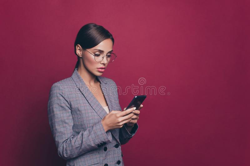 Portrait of her she nice cute attractive lovely sweet winsome classy gorgeous focused concentrated lady wearing gray. Checkered jacket using new device  over royalty free stock photos
