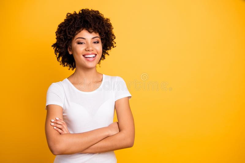 Portrait of her she nice cute lovely attractive charming cheerful glad wavy-haired girl wearing casual white t-shirt. Folded arms enjoying day isolated on stock photos