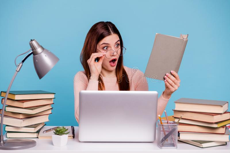 Portrait of her she nice-looking attractive amazed astonished stunned girl reading scientific article discovery at work. Portrait of her she nice-looking royalty free stock images