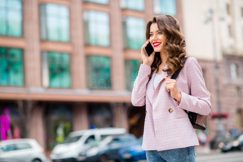 Portrait of her she nice-looking attractive charming winsome trendy cheerful cheery wavy-haired lady making call partner royalty free stock image