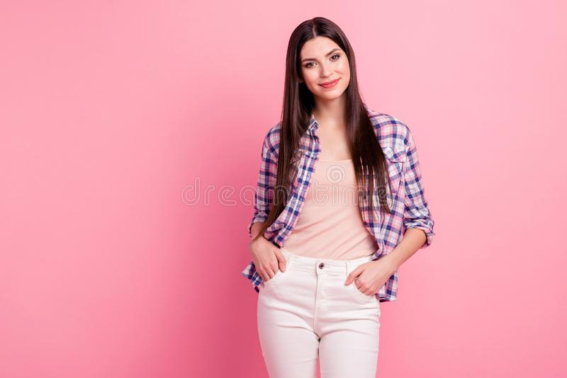 Portrait of her she nice-looking attractive cute charming well-groomed lovely adorable straight-haired lady holding. Hands in pockets isolated over pink pastel royalty free stock photography