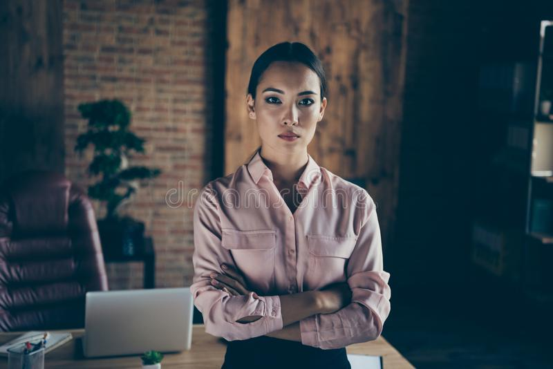 Portrait of her she nice-looking attractive elegant bossy stylish trendy content lady shark expert folded arms at modern. Industrial loft interior style work stock photo