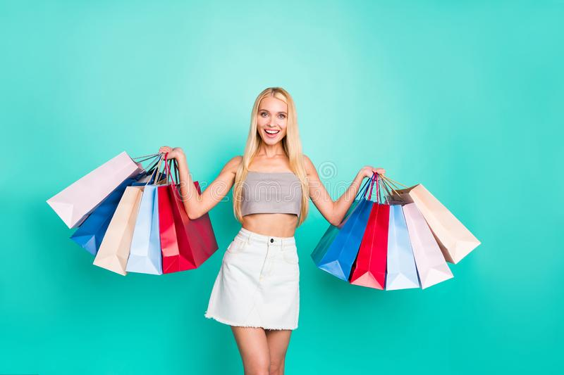 Portrait of her she nice-looking attractive lovely slim fit thin cheerful cheery straight-haired girl carrying many new. Portrait of her she nice-looking stock photo