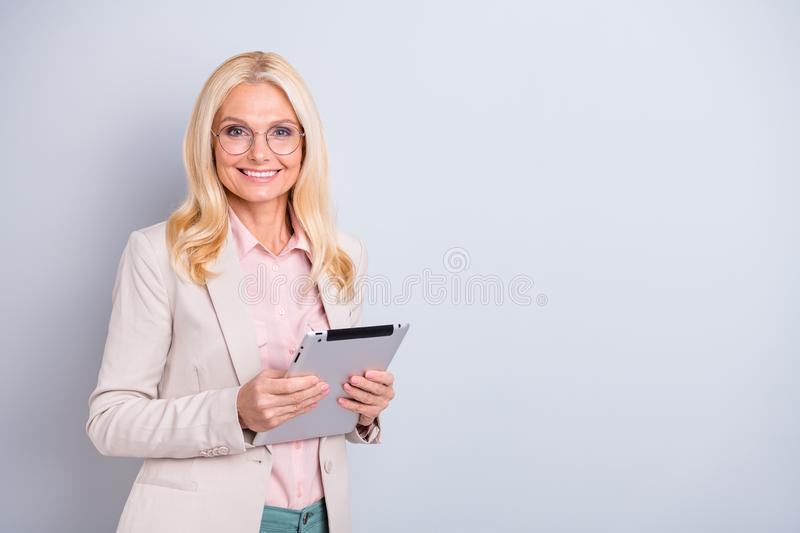 Portrait of her she nice-looking attractive stylish cheerful cheery wavy-haired lady hr manager holding in hands e-book. Portrait of her she nice-looking royalty free stock images