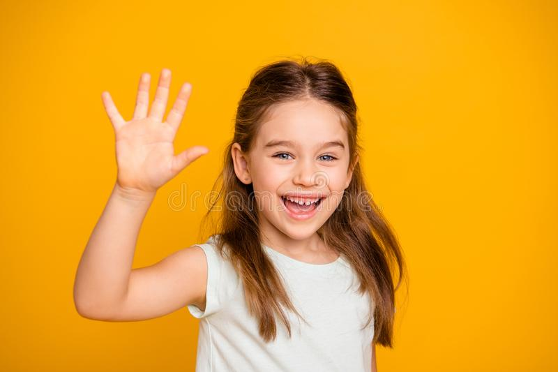Portrait of her she nice-looking cute attractive lovely pretty cheerful cheery positive pre-teen girl waving hi hello. Greetings I`m here isolated over bright stock images