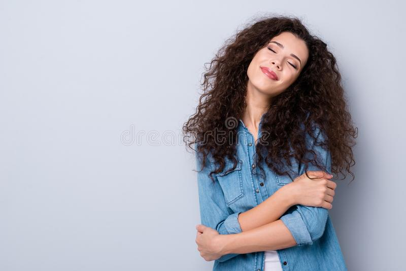 Portrait of her she nice-looking cute charming winsome attractive lovable lovely sweet tender cheerful dreamy wavy. Haired girl having fun hugging over gray stock photography
