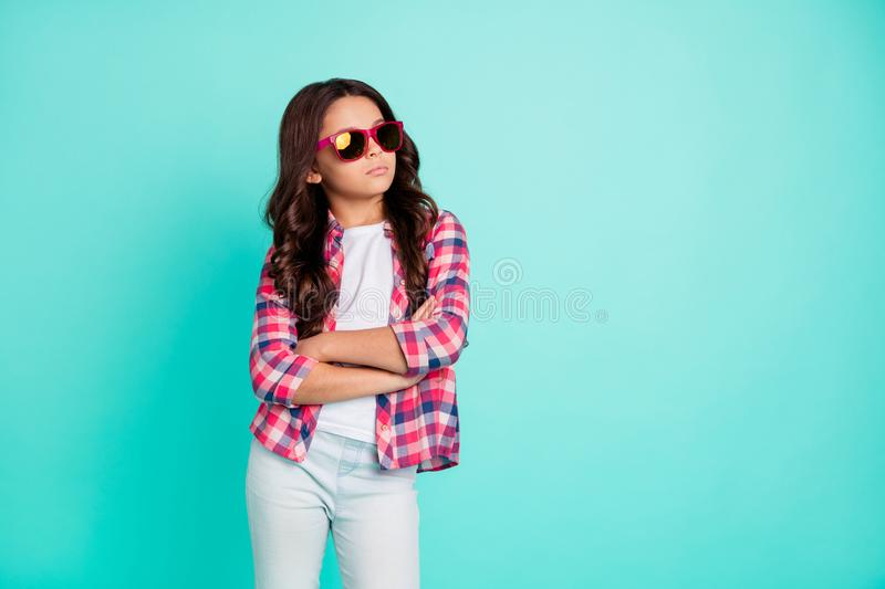Portrait of her she nice-looking fashionable attractive cool wavy-haired pre-teen girl wearing checked shirt folded arms. Isolated over bright vivid shine green royalty free stock photos