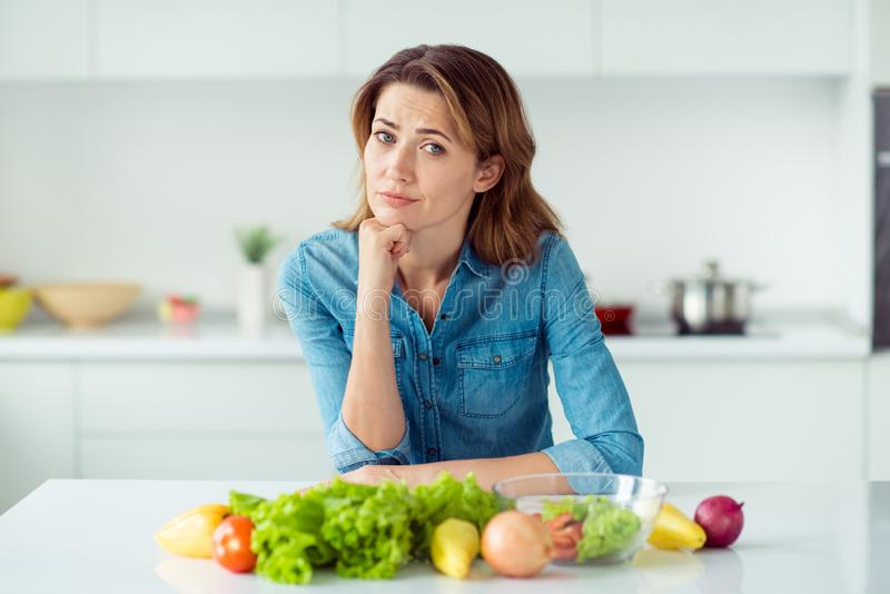 Portrait of her she nice lovely charming cute attractive sad bored brown-haired lady amateur culinary specialist stock photo