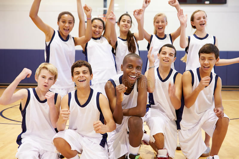 Portrait Of High School Sports Team In Gym. Portrait Of Happy High School Sports Team In Gym Cheering royalty free stock photos