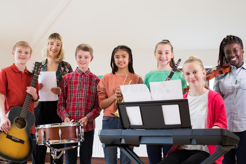Portrait Of High School Students Playing In School Orchestra Wit royalty free stock photos