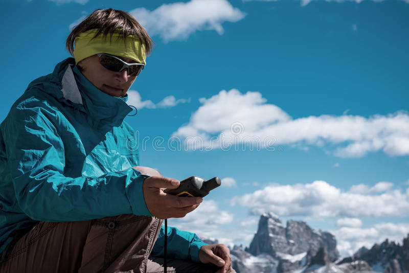 Portrait of hiker woman GPS navigator in mountains royalty free stock images