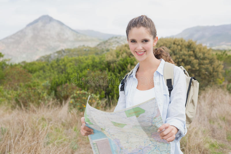 Portrait of a hiking young woman holding map stock photo