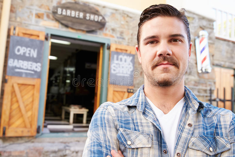 Portrait Of Hipster Barber Standing Outside Shop royalty free stock photos