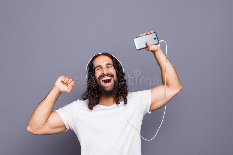 Portrait of his he nice attractive cheerful cheery overjoed wavy-haired guy rejoicing dancing disco having fun isolated royalty free stock photography