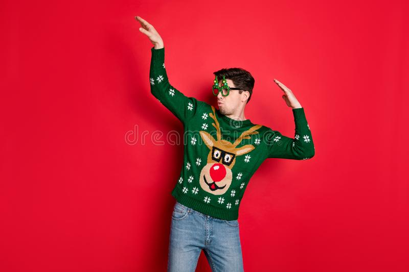 Portrait of his he nice attractive cheerful funny funky cool guy wearing deer sweater having fun dancing chill out. Portrait of his he nice attractive cheerful stock image