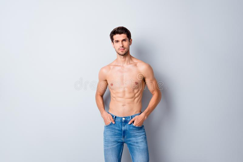 Portrait of his he nice attractive content cool fashionable muscular shirtless guy perfect figure form shape wearing stock photography