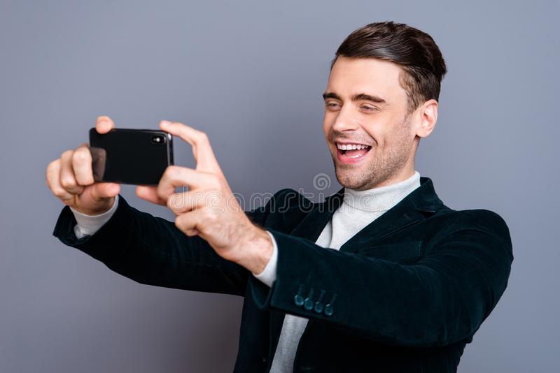 Portrait of his he nice attractive handsome bearded cheerful cheery positive guy wearing velveteen blazer making taking. Selfie day isolated over gray blue royalty free stock photography