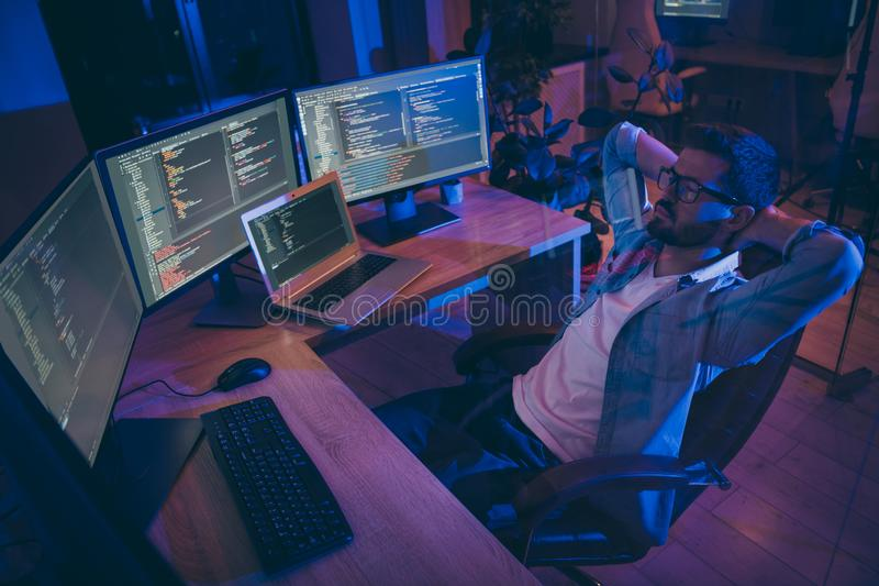 Portrait of his he nice attractive skilled expert guy monitoring remotely many projects online internet intranet royalty free stock photography