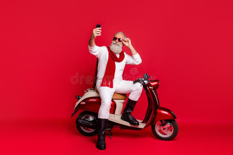 Portrait of his he nice attractive stylish trendy confident content cool gray-haired man taking making selfie touching. Portrait of his he nice attractive stock photo