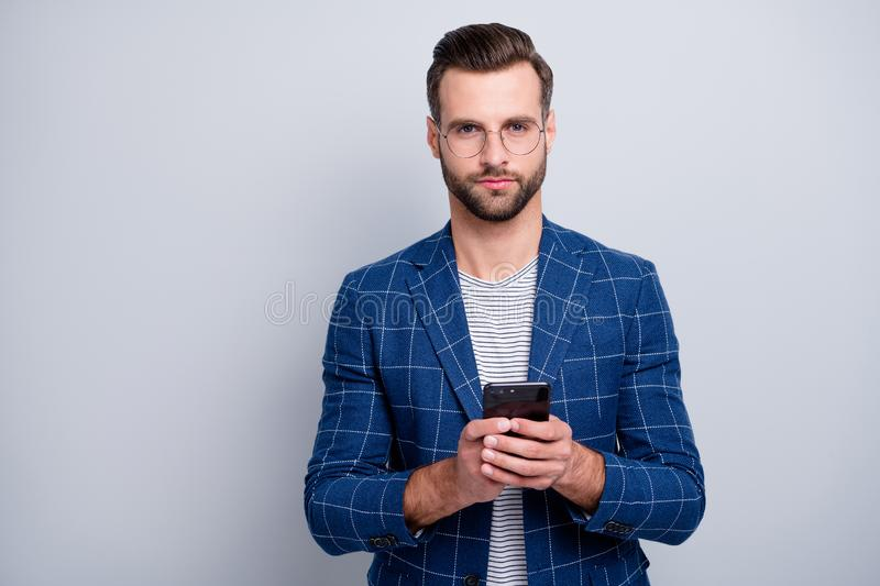 Portrait of his he nice classy serious attractive well-dressed groomed imposing bearded guy in checked blazer using 5g fotografia de stock