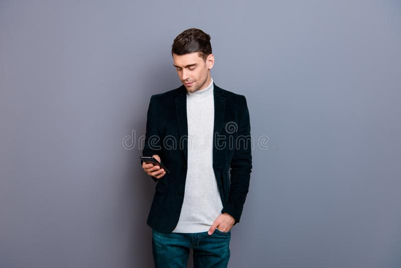 Portrait of his he nice cute attractive bearded cheerful guy wearing velveteen blazer using new cellular wi-fi shopping. Easy isolated over gray violet purple stock images