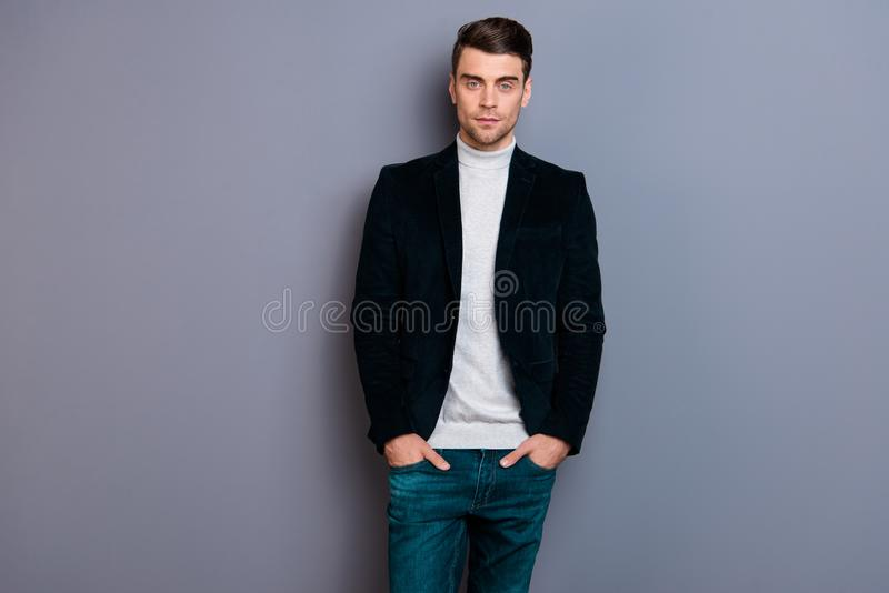 Portrait of his he nice cute handsome attractive chic bearded guy wearing velveteen blazer sweater holding hands in. Pockets isolated over gray violet purple stock photography