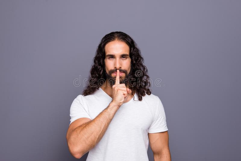 Portrait of his he nice groomed attractive candid minded wavy-haired guy showing shh symbol isolated over gray violet royalty free stock photography