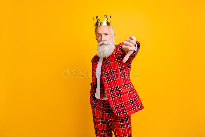 Portrait of his he nice handsome attractive proud serious gray-haired man wearing crown showing thumb down isolated over stock images