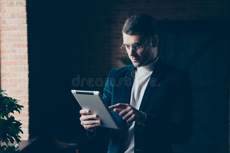 Portrait of his he nice handsome stylish trendy clever smart guy specialist customer support holding in hands e-book royalty free stock images