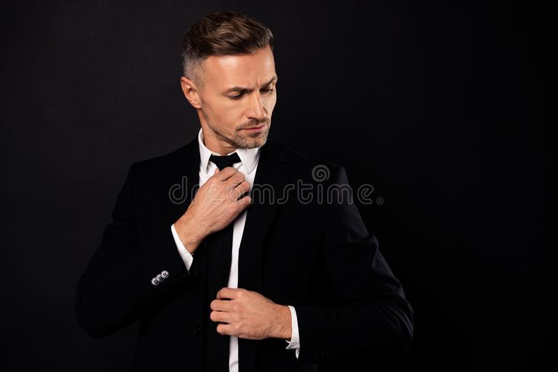 Portrait of his he nice-looking attractive well-groomed chic gorgeous content guy financier executive director economist. Attorney lawyer fixing tie isolated stock images