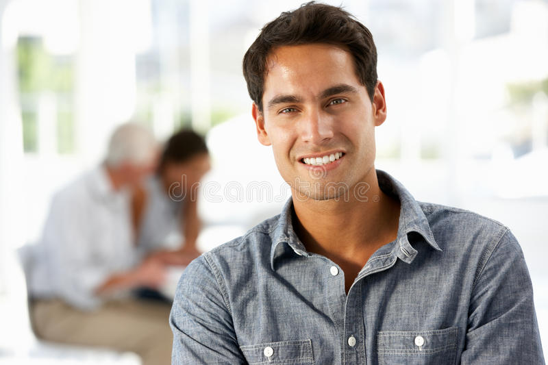 Portrait of Hispanic businessman in office stock images