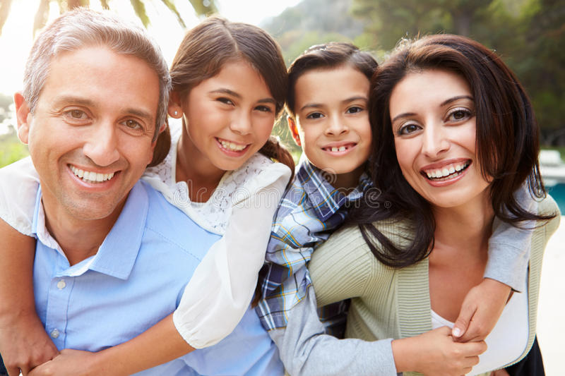 Portrait Of Hispanic Family In Countryside. Smiling At Camera royalty free stock images