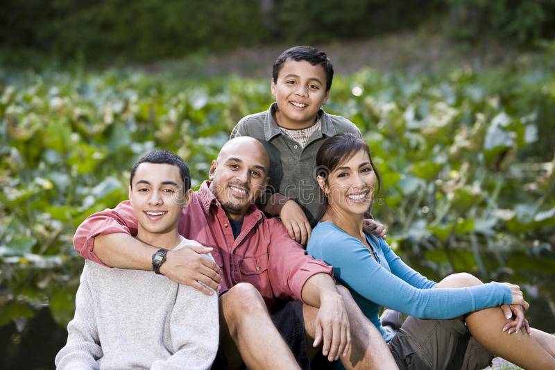 Portrait of Hispanic family with two boys outdoors royalty free stock photography