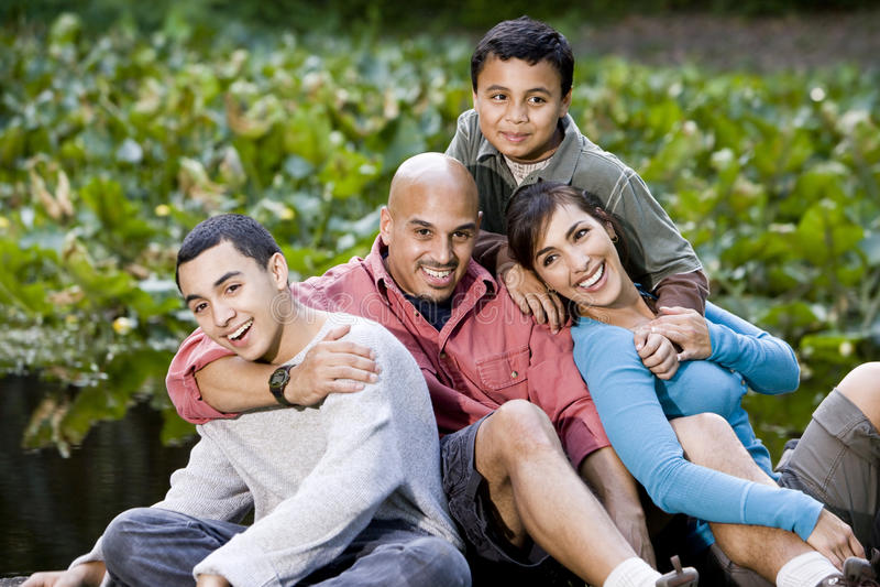 Portrait of Hispanic family with two boys outdoors stock photos