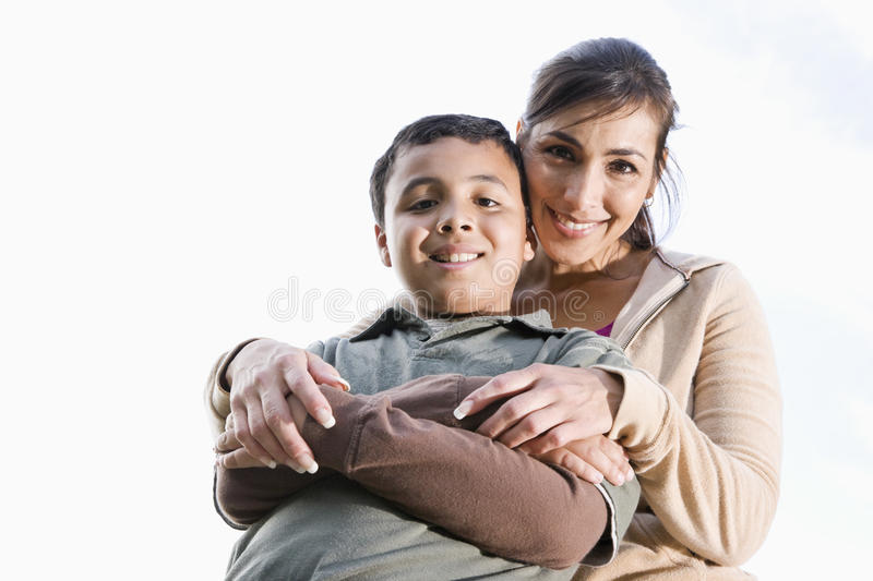 Portrait of Hispanic mother and son outdoors stock images