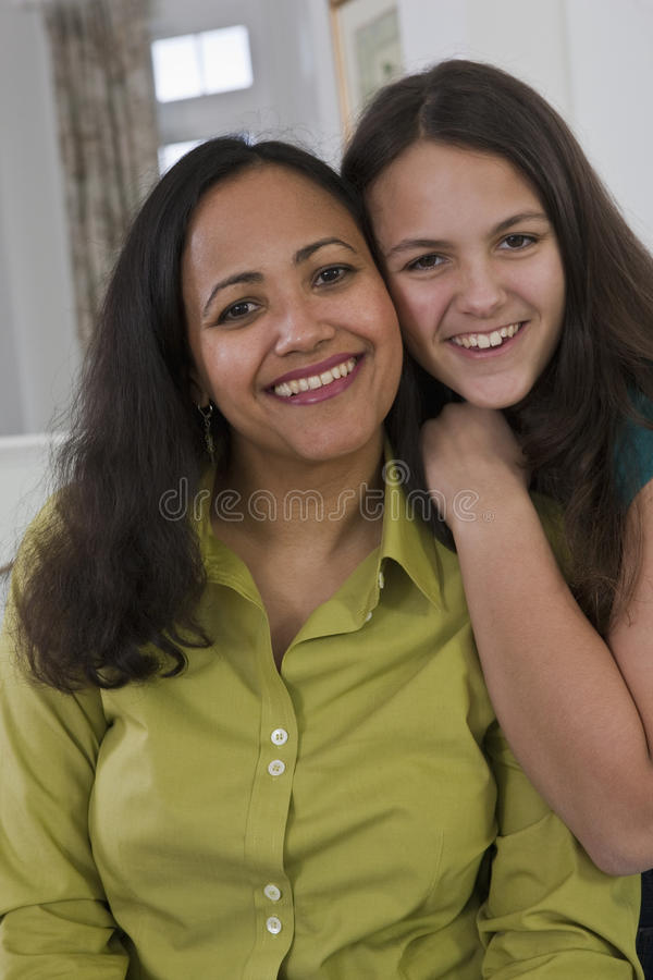 Portrait of a hispanic teenage girl and mother stock images