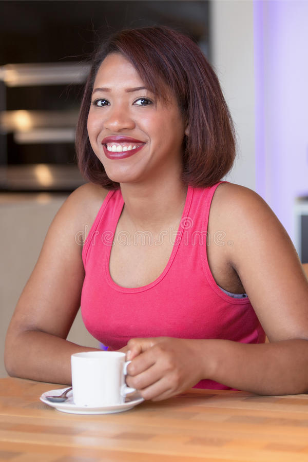 Portrait of hispanic woman drinking coffee royalty free stock images