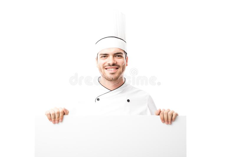 Young chef holding a sign stock photos
