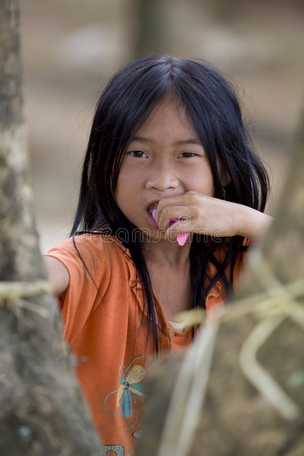 Portrait Hmong girl Laos. In a mountain village of the province Luang Prabang stock image