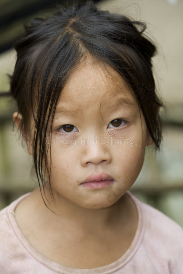 Portrait Hmong girl Laos. In a mountain village of the province Luang Prabang royalty free stock image
