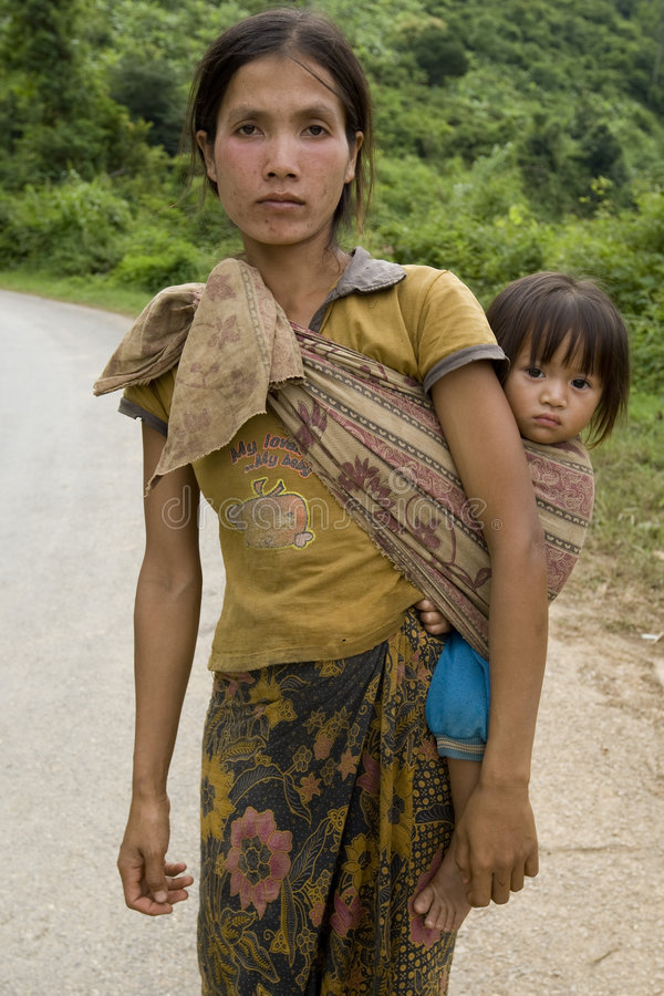 Portrait Hmong woman with baby. At a street in the District Khanthao royalty free stock photo