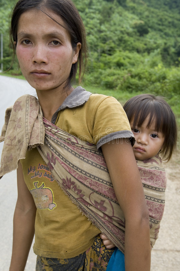 Portrait Hmong woman with baby. At a street in the District Khanthao stock images