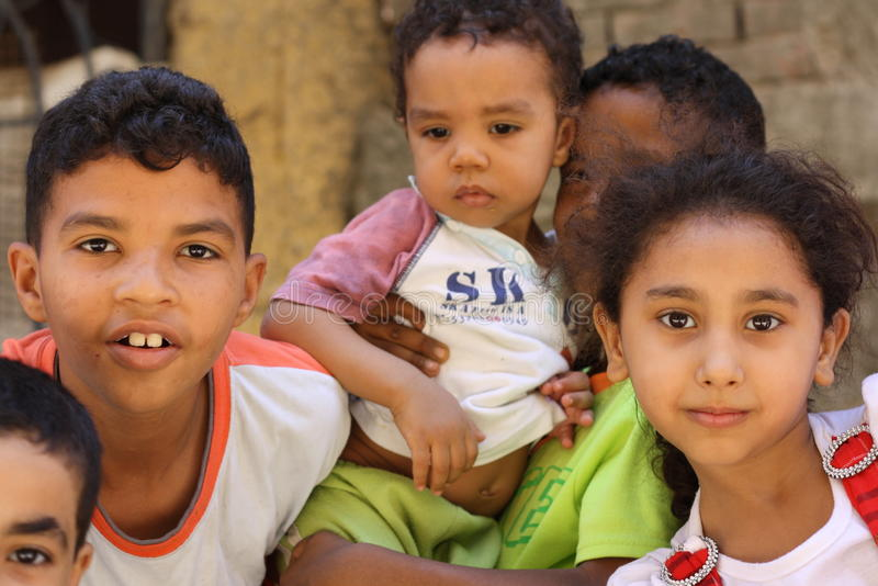 Portrait of homeless egyptian children in chairty event stock photo
