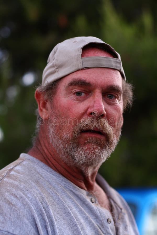 Portrait of a homeless man royalty free stock photography