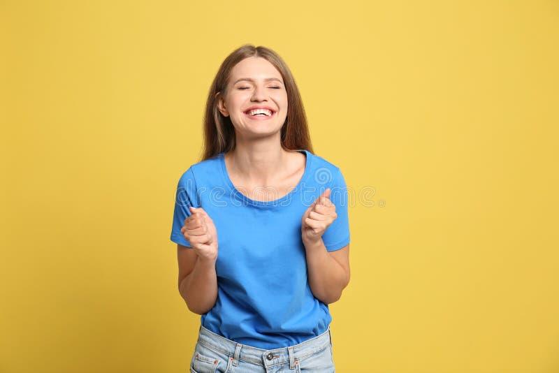 Portrait of hopeful woman on background royalty free stock image