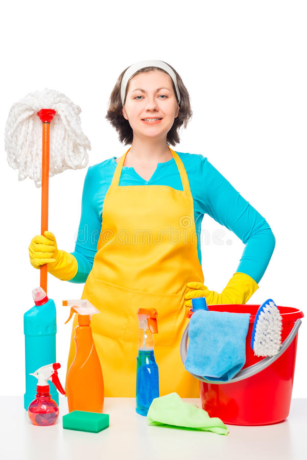 Portrait of a housewife with a mop and cleaning agents royalty free stock photos